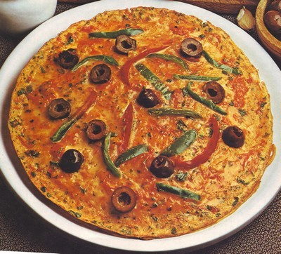 frittata di uova peperoni e olive,frittata,frittata ai pereroni,frittata alle olive,paprica,panna